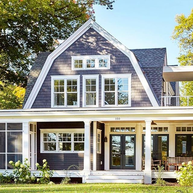 It S Timeless Lakeside Living Inside A Cape Cod Home Select An Architectural Style Befitting Of Your Person House Exterior Dutch Colonial Homes Colonial House