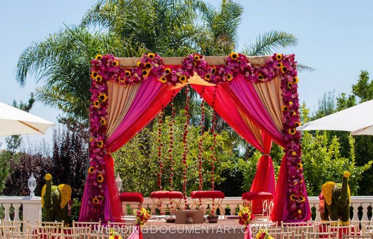 gorgeous pink with sunflowers outdoor mandap