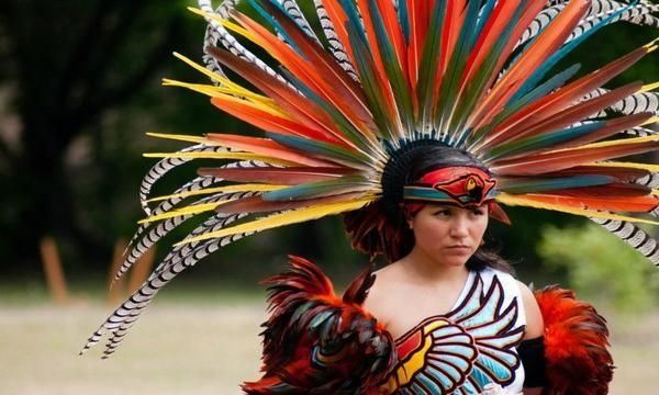 """Monica Villarreal of Danza Azteca Taxcayolotl. """"You have your flesh, you have your blood, and you have your freedom."""" — Debra White Plume, founder of the Owe Aku (Bring Back the Way) International Justice Project at Pine Ridge Reservation."""
