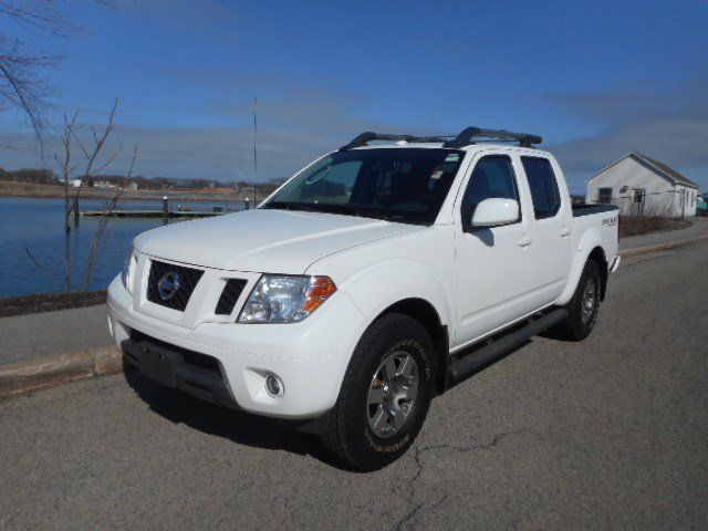 Certified Used 2011 Nissan Frontier PRO-4X Crew Cab Pickup for sale - only $18,990. Visit Quirk Nissan in Quincy MA serving Braintree, Boston and Weymouth #1N6AD0EV0BC403276