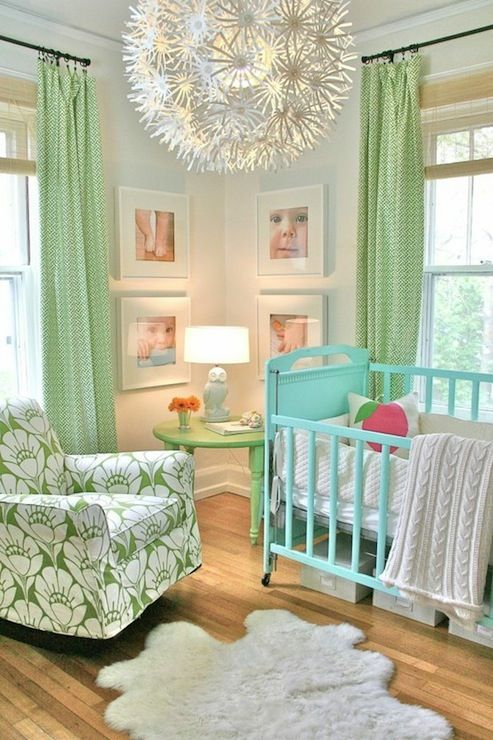 Trenna Travis Design Studio - White walls paint color, Ikea PS MASKROS Pendant, turquoise blue Mitchell Gold + Bob Williams crib, green accent table painted Valspar Apple and curtains in Waverly Cross Section Green, white owl lamp and white & green floral glider.