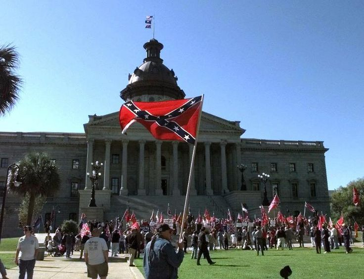 Forward Flags Fly Atop The Dome Of The South Carolina Statehouse