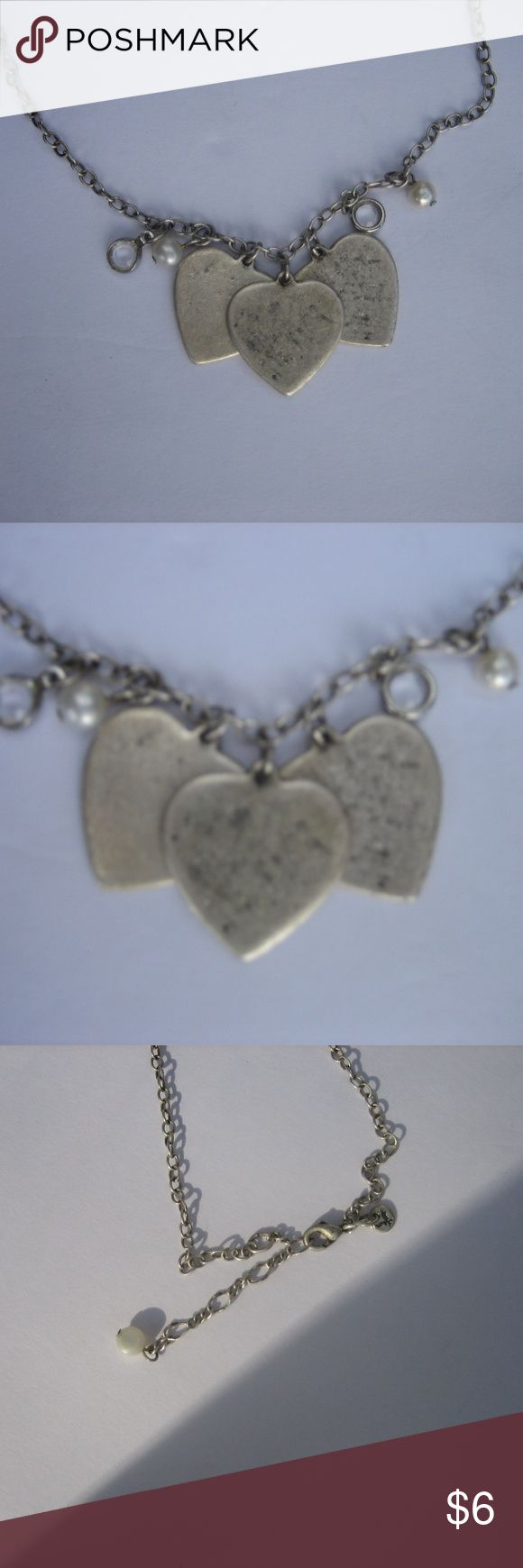 """Women's American Eagle Triple Heart Necklace Materials: Silver tone chain. Three silver tone heart charms. Two faux crystal charms. Two faux pearl charms. Claw clasp.  Details: The necklace length is adjustable, American eagle logo charm is located on clasp. Necklace is lightweight.  Flaws: The heart pendants have light wear.  Measurements: Full Extended Length:18 1/2"""", Pendant Width(each):3/4"""". American Eagle Outfitters Jewelry Necklaces"""