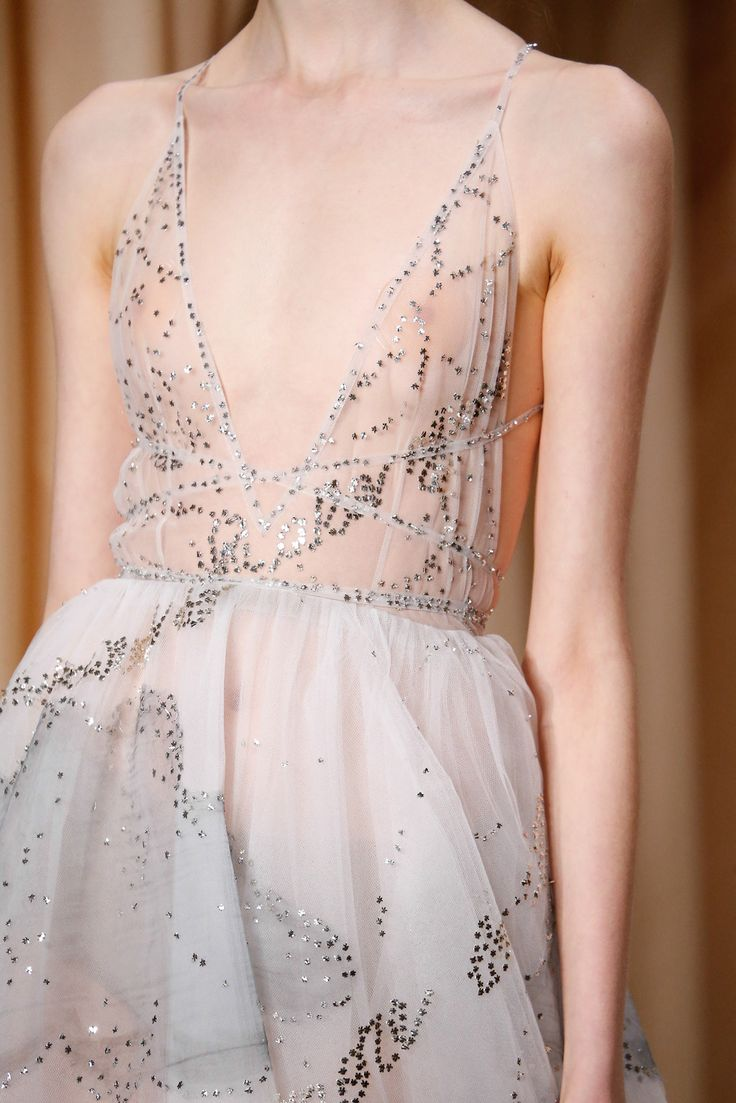 DJ3-Valentino spring 2015 couture. This light and delicate dress uses binding as detail and finsihing. One example is the neck line. Similar to the bound slit technique that we did in class, this neck line is bound and tacked at corner. The bindings then are extended and used as straps.