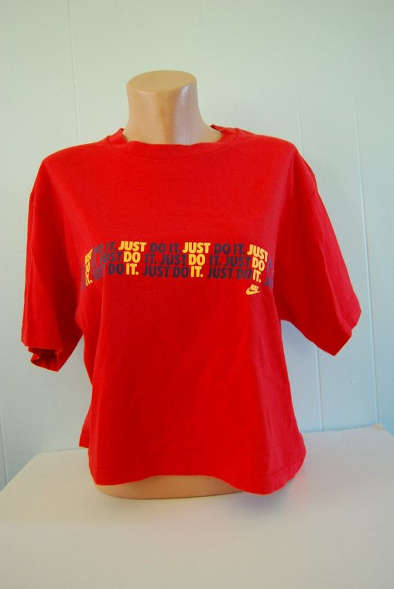 T-Shirt SIZE/FIT : Mens Medium that has been shortened for a Lady  (please refer to the measurements!)    Measurements:  19 Across from armpit to armpit  20 Down the front of the shirt    Softness: 9.5/10  Thinness: 9.2/10  Condition: 9/10    T-Shirt Color : Red    Condition : A cool, old Nike shirt...its short, so its perfect for ladies. Nicely worn, with no damage. No stains, holes or rips!    Please email any questions