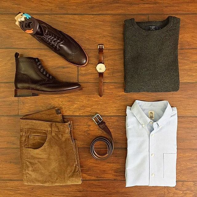 Follow @inisikpe for daily style #suitgrid to be featured ________________________________________ #SuitGrid by @chrismehan ________________________________________ Tap For Brands Sweater: @jcrew Oxford Shirt: @katobrand Trousers: @jachsny Shoes/Belt: @thursdayboots Socks: @vybesocks Watch: @fossil