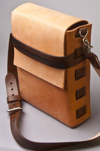 Men's lightly tooled leather bag. (by TrimGoTrix) ~ I'd slap some beaded tassels on there and an old/vintage metal medallion and use it as a purse! ;)