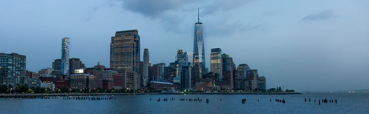 The WTC - Lower Manhattan skyline right after sunset during blue hour. Taken from the hudson river side.   Panorama of about 30MP. Full resolution files can be provided.