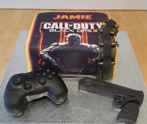 Call of duty black ops 3 cake with a pistol and xbox controller