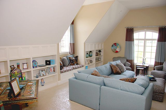 built-in shelving for low wall; sectional and chair