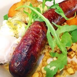 Photo of Nopa - San Francisco, CA, United States. Smoked Andouille: Roasted Corn, Sungold Tomato, Basil–Lime Butter, Cornbread, and Poached Eggs