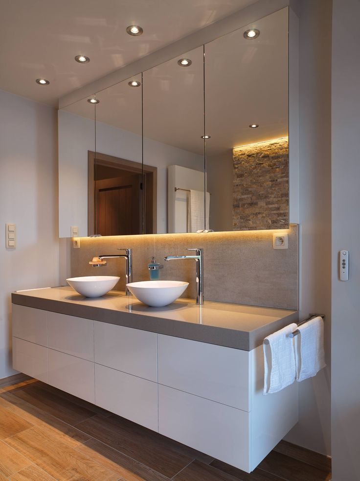 like the storage here behind long large mirror and below also like the bowl sink style