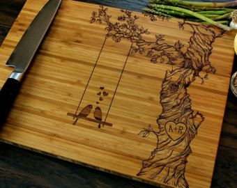 This cutting board is customizable! The two initials and date can be changed to your own choices. Please leave me your choices in the notes section @ checkout. Our eco-friendly custom engraved cutting boards are a very unique, and fun way to add something new and different to your kitchen. These make the perfect wedding gifts, anniversary gifts, birthday gifts or holiday gifts for anyone. Our cutting boards are double-sided! The engraved side can be displayed as a beautiful piece of kitchen…