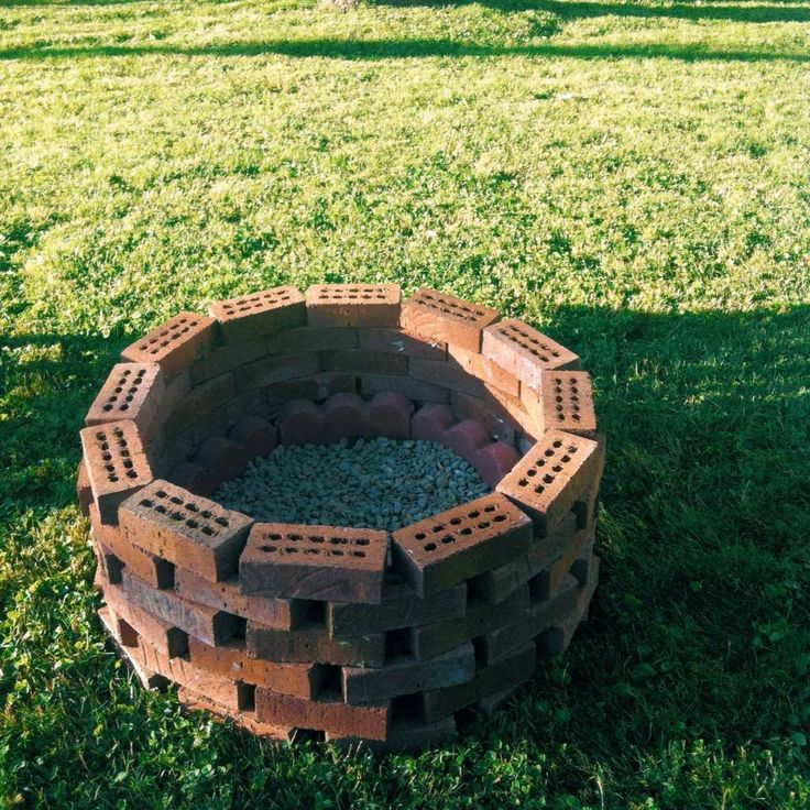 Fire pit! $3 in rocks a some old bricks I found in the garage.