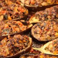 Meat- Stuffed Eggplant. I am not a fan of eggplant. This recipe was good and I was able to eat thee eggplant. I did not add a chopped hard boiled egg. I didn't see the point of adding one to the mixture. I did add one raw egg to bind the mixture together. I also added 4 minced cloves of garlic to the mixture.