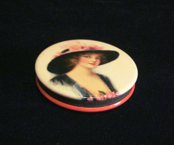 This is a rare advertising powder compact tin from Peoples Bank of North Kansas City, Missouri. It in fabulous condition and has a enamel portrait of a lovely Victorian lady on one side and the bank a