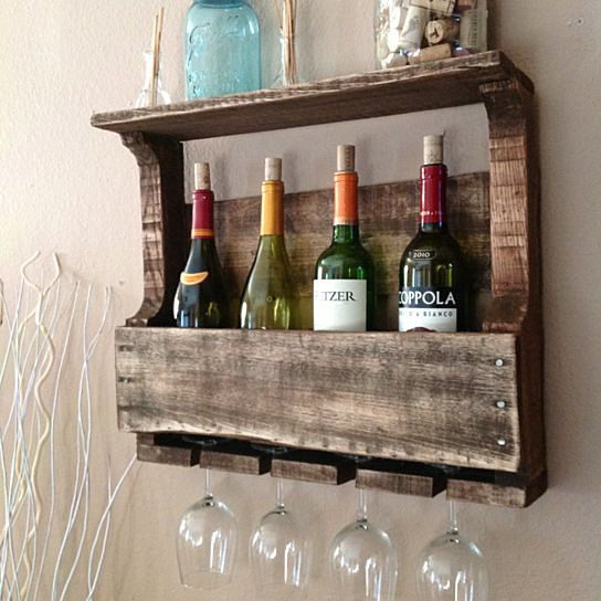 This item is salvaged from %100 reclaimed wood. Anything can be reusable and functional with the right kind of hands or creative eye, behind the making!Small yet functional, this wine rack can hold 4 long stem glasses and 4 wine bottles perfectly! The top shelf can be used for decor or more wine/glasses. The unique color is created by a coat of stain, slightly distressed Every piece we create is its own creation. We do our best to match our photos but wood does what it wants. This is the...