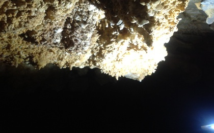 Cave Foros, an impressive spectacle composed of stalactites, stalagmites, and helictites, hanging rocks, colorful limestone and gour formations.