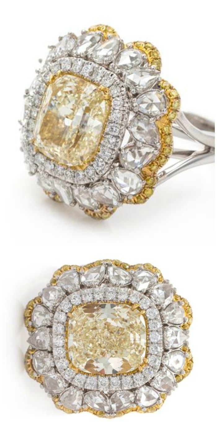 A beautiful diamond ring featuring both white and yellow diamonds with a center diamond of 5.57 carats.