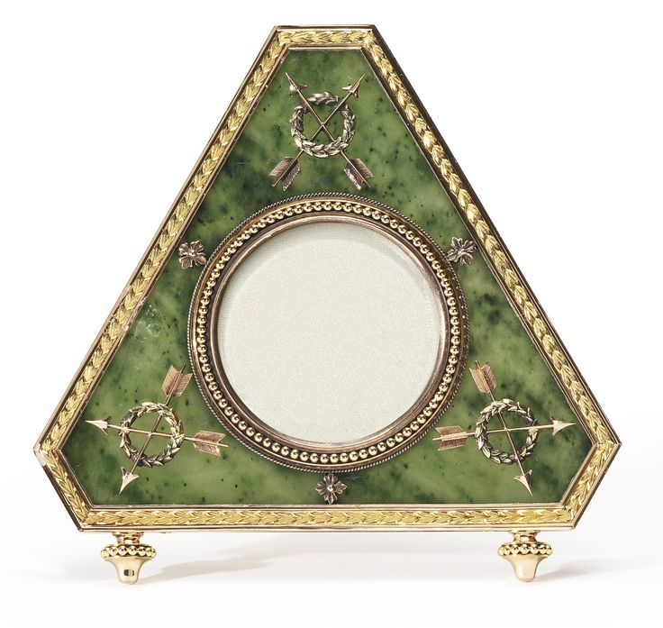 A Fabergé varicolor-gold mounted carved nephrite photograph frame, workmaster Michael Perchin, St. Petersburg, circa 1895