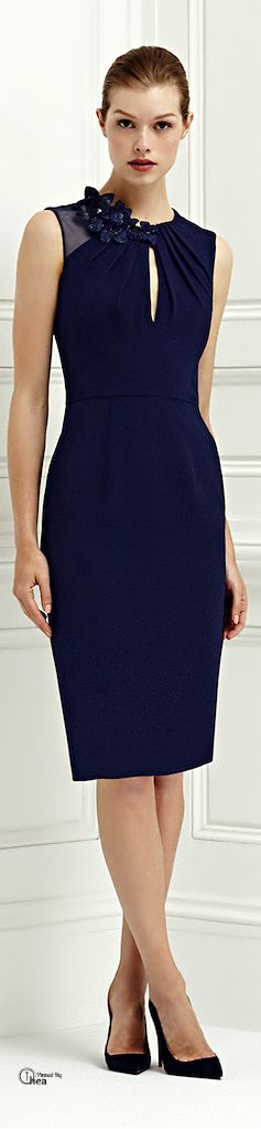 Jenny Packham Cruise Spring/Summer 2014. This navy blue pencil dress is ideal. The subtle cut-out, the pleated detailing, the one-sided sheer sleeve, and of course, the darling floral addition makes for one heck of a dress.