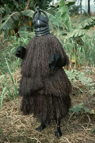 "Africa | A Mende person wears the costume of the female demon ""Sowei"" in Sierra Leone 