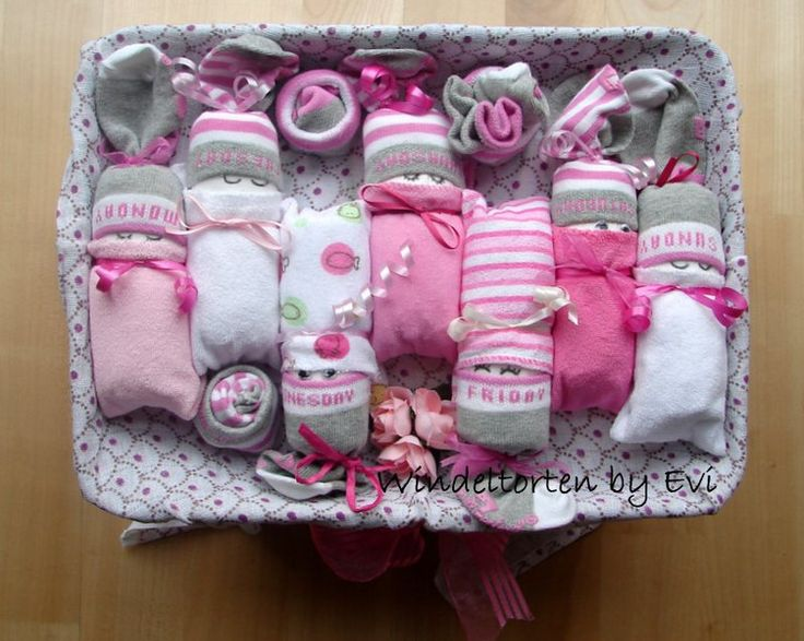 diaper babies on top of a box filled with diapers; weekdays socks by 7 for all mankind - super cute!