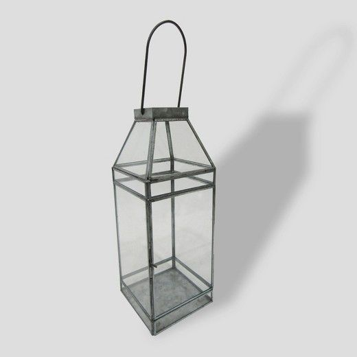 Add charm to your patio space with the Galvanized Glass Lantern from Threshold™. This rustic glass candleholder is shaped like an old-fashioned lantern to add a touch of antique character to any space. Made with glass and steel, this classic lantern is coated in a protective layer of zinc for all-weather durability. The square face and elongated handle add to the authenticity of the piece, making it a perfect complement to a variety of decorating themes.