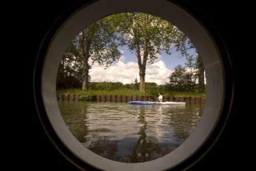 A View of the Canal from a Cabin Porthole