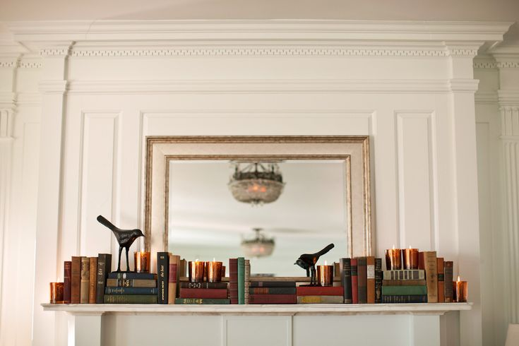 Thrifted Books On The Mantle At The Marion Davie Beach
