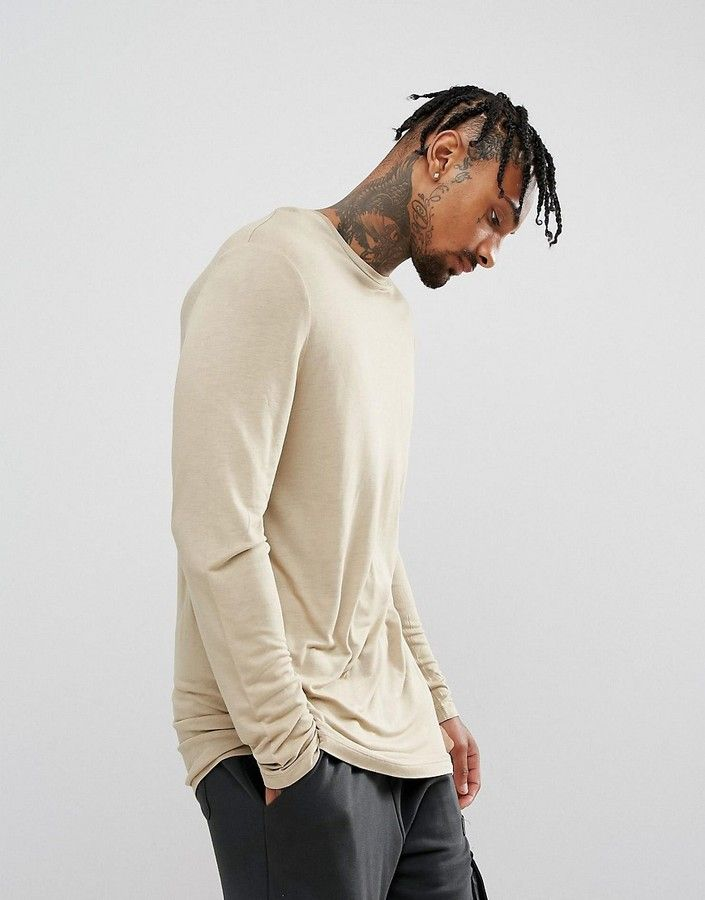 "ASOS Relaxed Longline Long Sleeve T-Shirt In Drape Viscose Fabric In Beige $16.00 Free delivery & returns. Smooth drape fabric, Crew neck, Long sleeves, Longline cut, Cut longer than standard length Length: 78cm/31"", Our model wears a size Medium and is 185.5cm/6'1"" tall"
