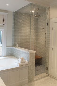 Shower next to tub- half wall and euro glass surround