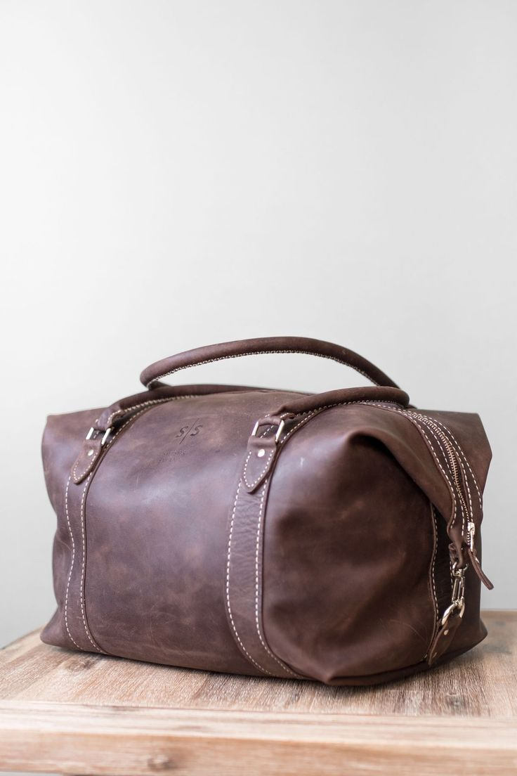 Every stitch is done by hand to create a bag that is stylish and durable.  Get this hand-stitched brown leather duffle online