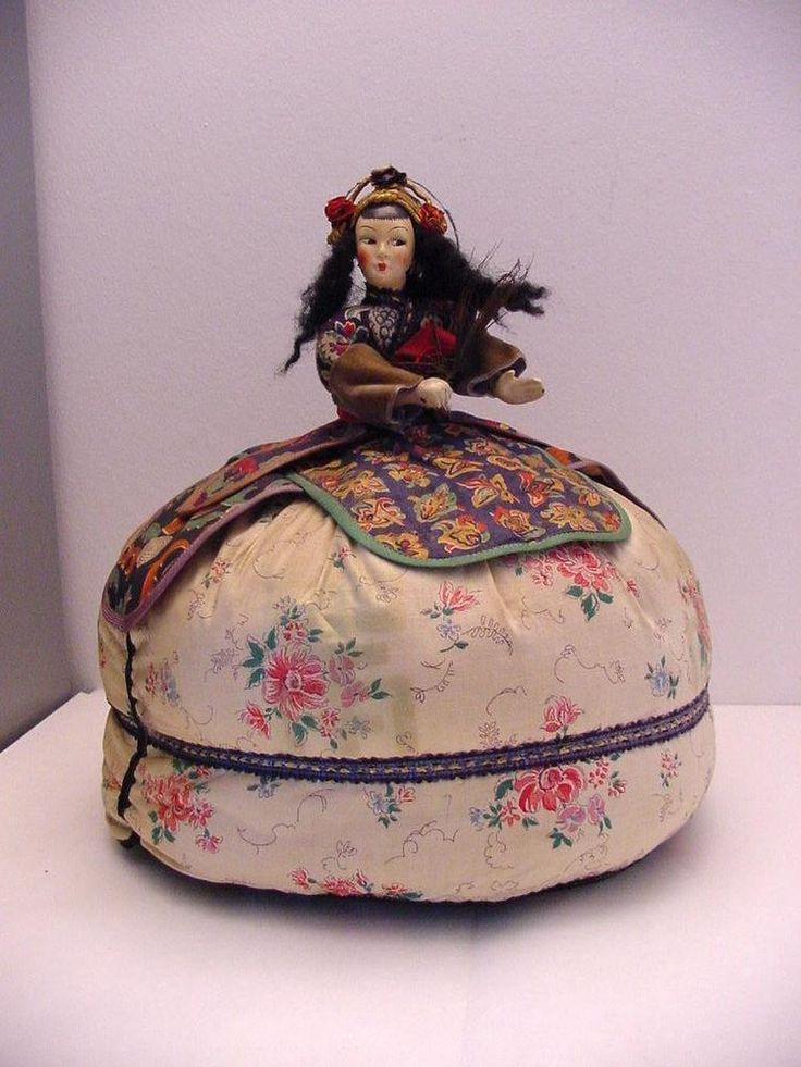 antique Japanese doll, tea cosy