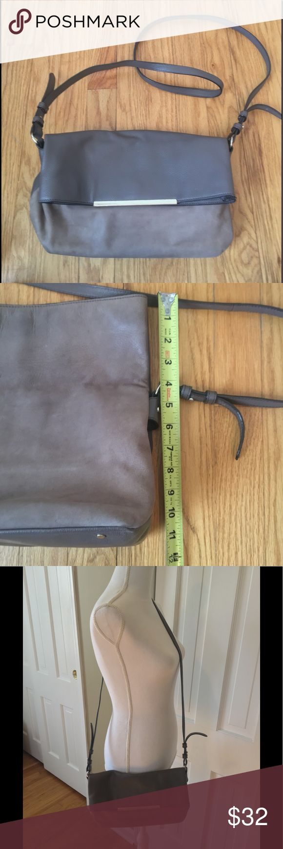 Banana Republic leather and suede crossbody bag Taupe color.  One main compartment with 3 pockets inside for phone and keys. Magnet closure.  Gold hardware. In good condition, but there is some wear on the bottom as shown in the last image. Banana Republic Bags Crossbody Bags