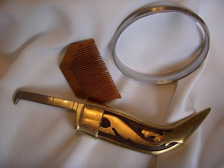 The five Ks, symbols of Sikhism:  Kesh-uncut hair  Kanga-wooden comb  Katchera-cotton underwear  Kara-iron bracelet  Kirpan-curved sword