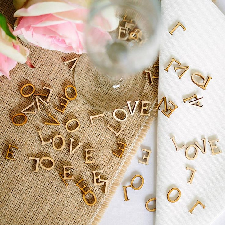 You don't have to just use your wedding confetti in photos – this wooden table confetti from Artcuts is really pretty and will dress up your reception tables nicely.