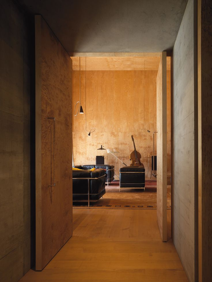 Peter Zumthor - Architect's own home, Haldenstein, 2005. Amazing how a door that large on that type of hinge is so tight to the ceiling and floor. Previously, 2 via, 2, photos (C) Pietro Savorelli.