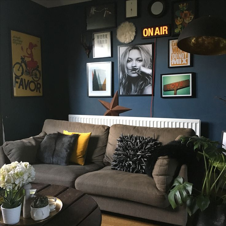 Living room painted in farrow & Ball Stiffkey Blue, gallery wall, dark interiors.