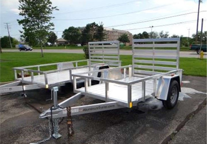 "Open Aluminum 5' x 8' Utility Trailer ATC – Aluminum Trailer Company. This Is a Very Nice 5' x 8' Utility Trailer with a Rear Ramp Gate and 12"" Railing. $1,995 Any applicable fees and taxes are extra. Ref # HE206604 