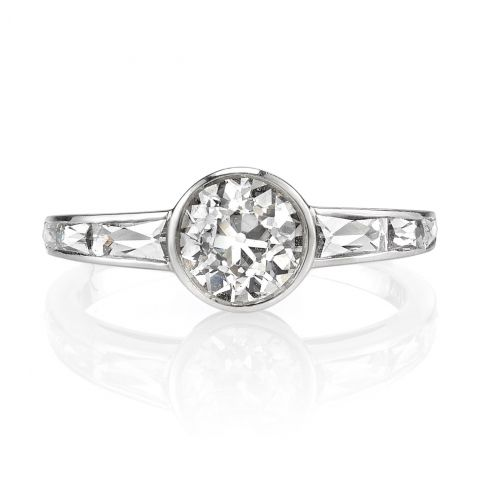 1.28ct I/VS2 EGL certified old European cut diamond set in a handcrafted platinum mounting. A contemporary design that is bezel set and features beautiful french cut accents.