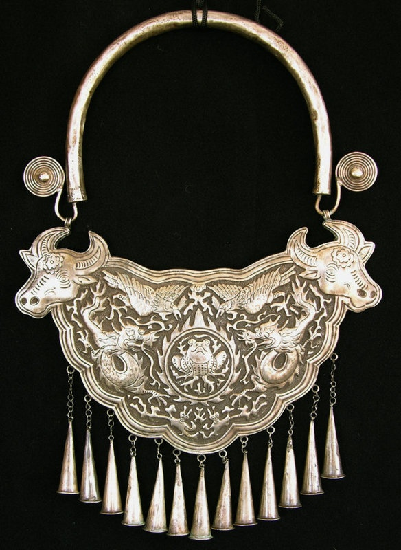 A silver festival necklace from one of the Miao villages in the mountains outside the city of Tia Jiang, China,. pre 1920. Newly made non traditional tourist item found in markets and shops sold as old LP