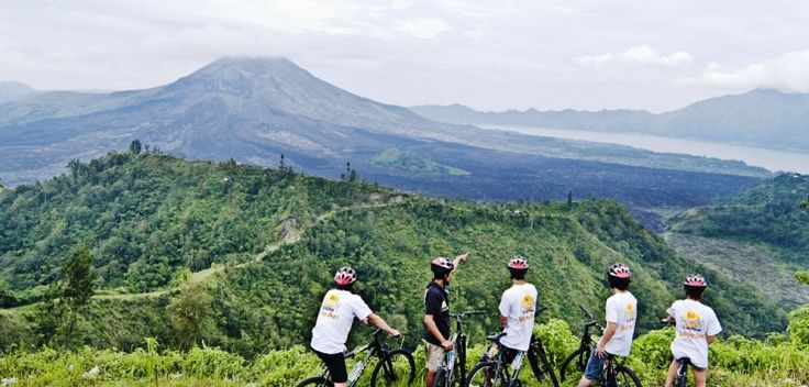 BICYCLING Discover nature and authentique Bali in different and wonderful way by Biking Track.  Starting in view of Mount Batur volcano at Kintamani, this breathtaking bicycle tour winds down through 16km of lush valleys, through Balinese villages, past century-old temples and rich green rice fields. This is one of the best adventures in Bali.