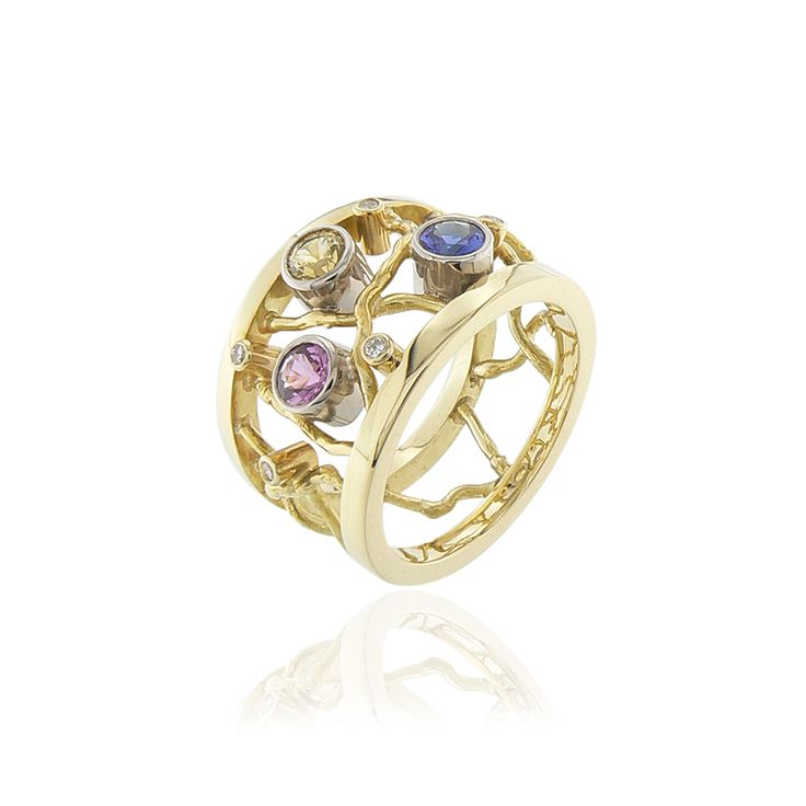 Yellow gold ring, sapphire in pink, yellow and blue, diamonds. Contemporary dutch design. Handmade by Sabine Eekels