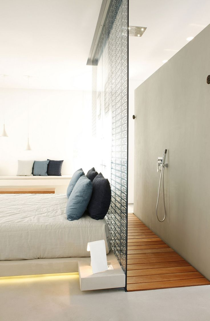 Interesting way to incorporate an open shower concept in a hotel room. The wood…
