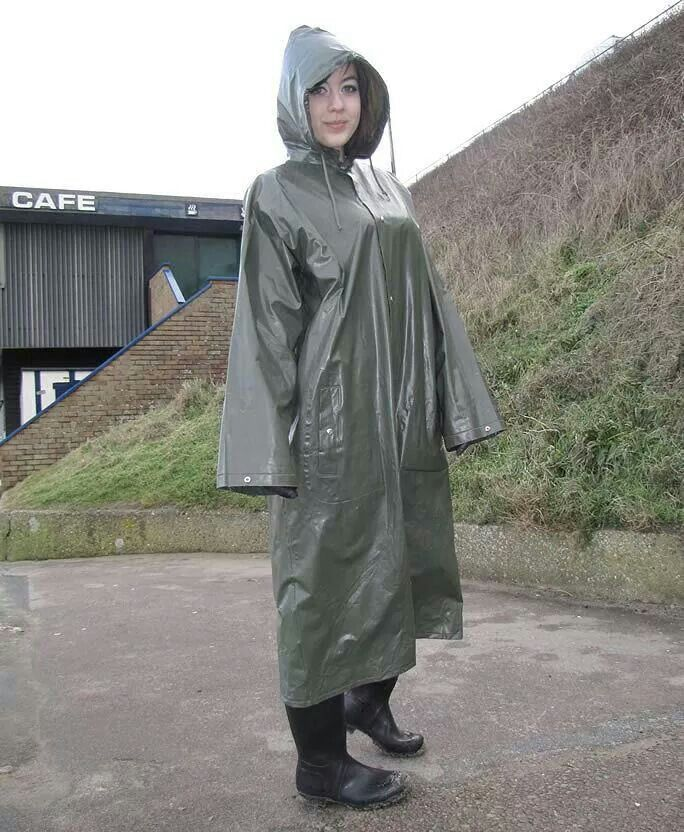 Well  protected in her hooded grey pvc mac & boots