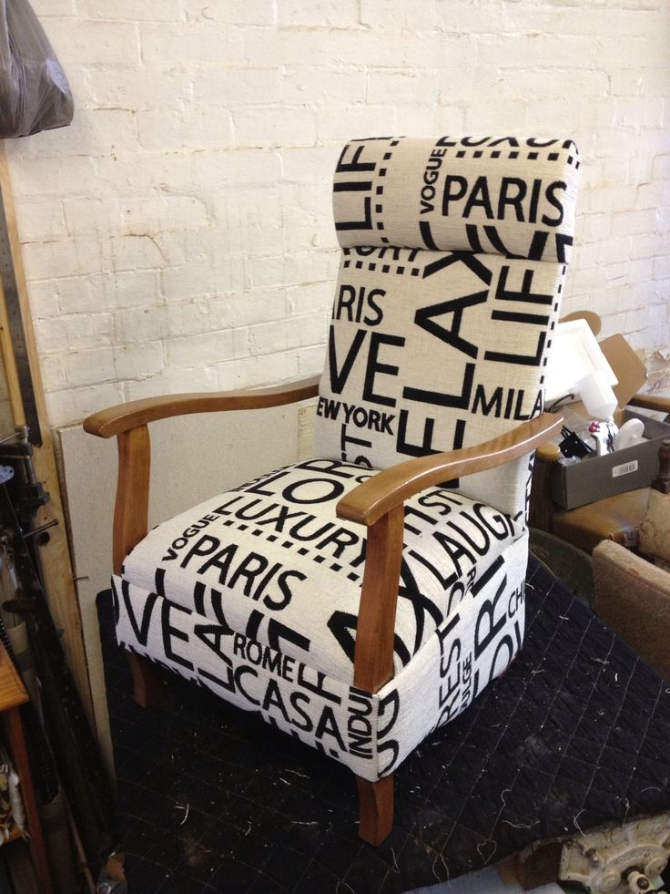 This vintage spring back rocker is fully restored in moma fabric from Warwick. - BytheBrooke.