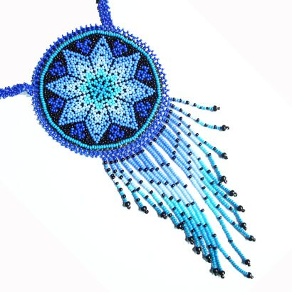 Rounded multi-color beaded pocket medallion made by Huichol natives from México. Soulmente.com