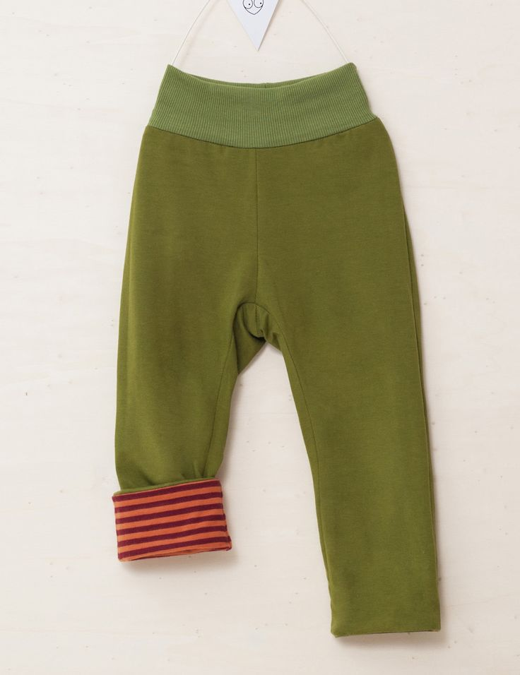 Soft, fun, and functional. These #baby #trousers are reversible, extending their lifespan throughout the week.  #reversible #stripes #organic
