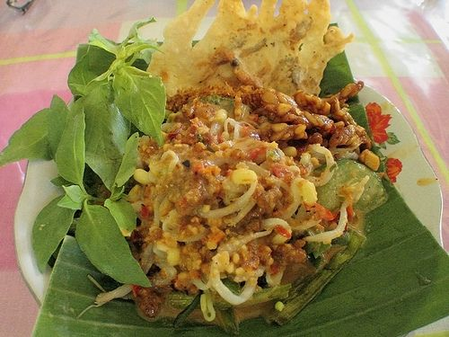 Pecel>Steamed vegetables (any veggies like spinach,cabbage, bean sprout) topped with peanut sauce. Eat with steamed rice. Additional: fresh basil, cucumber and peanut brittle.
